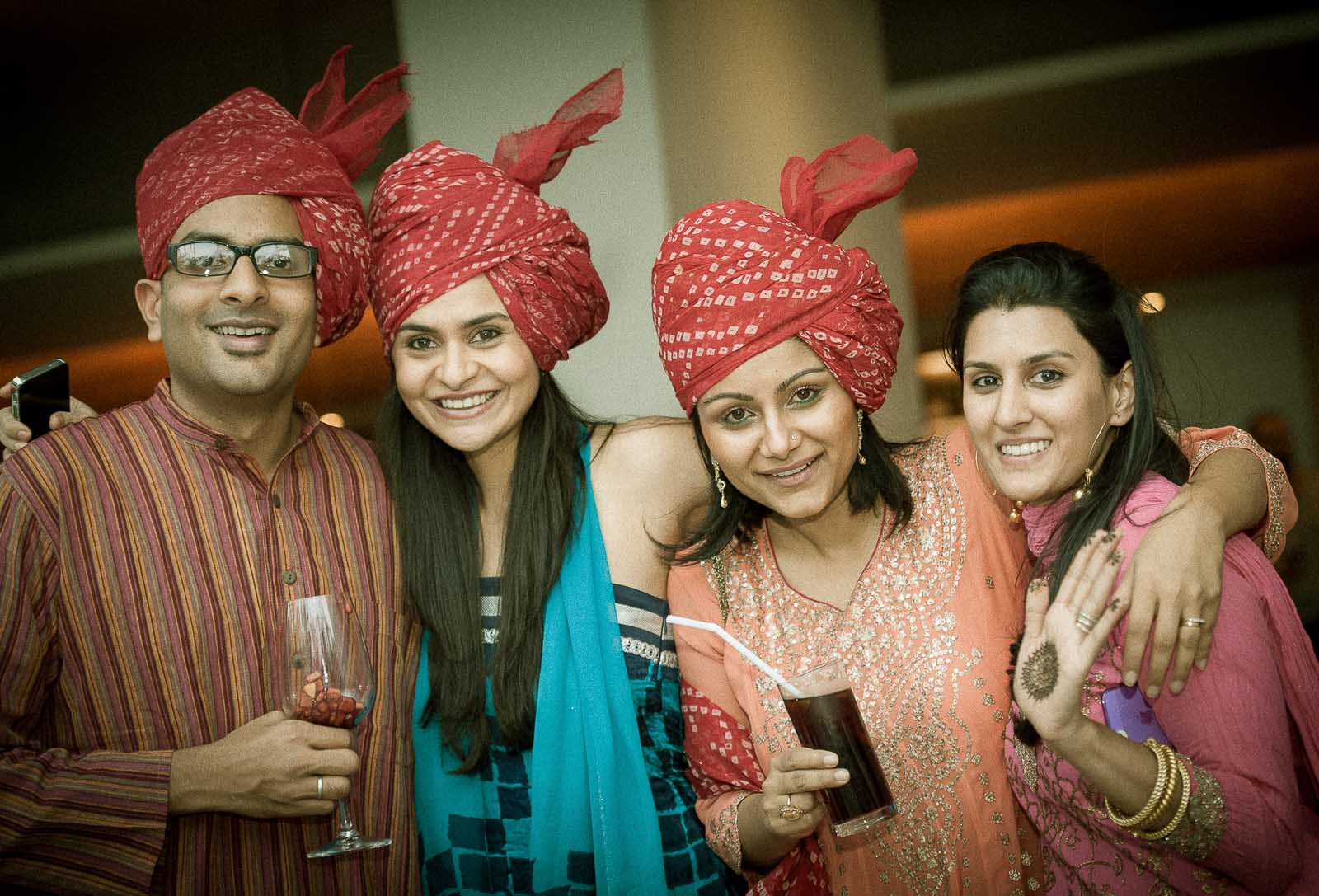 Best Wedding Photographer Bangalore India | Group Baraat Ladies Pagdi Alila Bangalore Portrait Photography