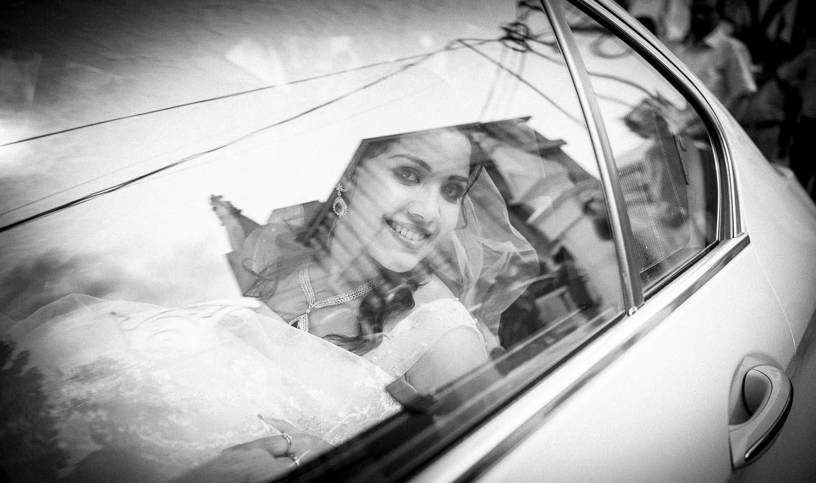 top-wedding-photographer-bangalore-bride-church-reflection
