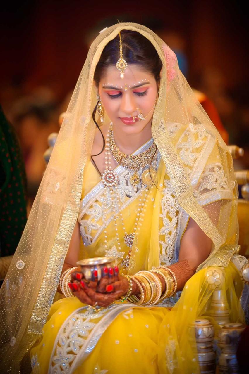 top-wedding-photographer-mumbai-grand-hyatt--bride-yellow-saree