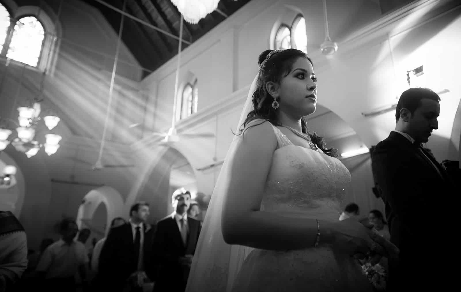 top-wedding-photographer-bride-showers-blessing-church-wedding
