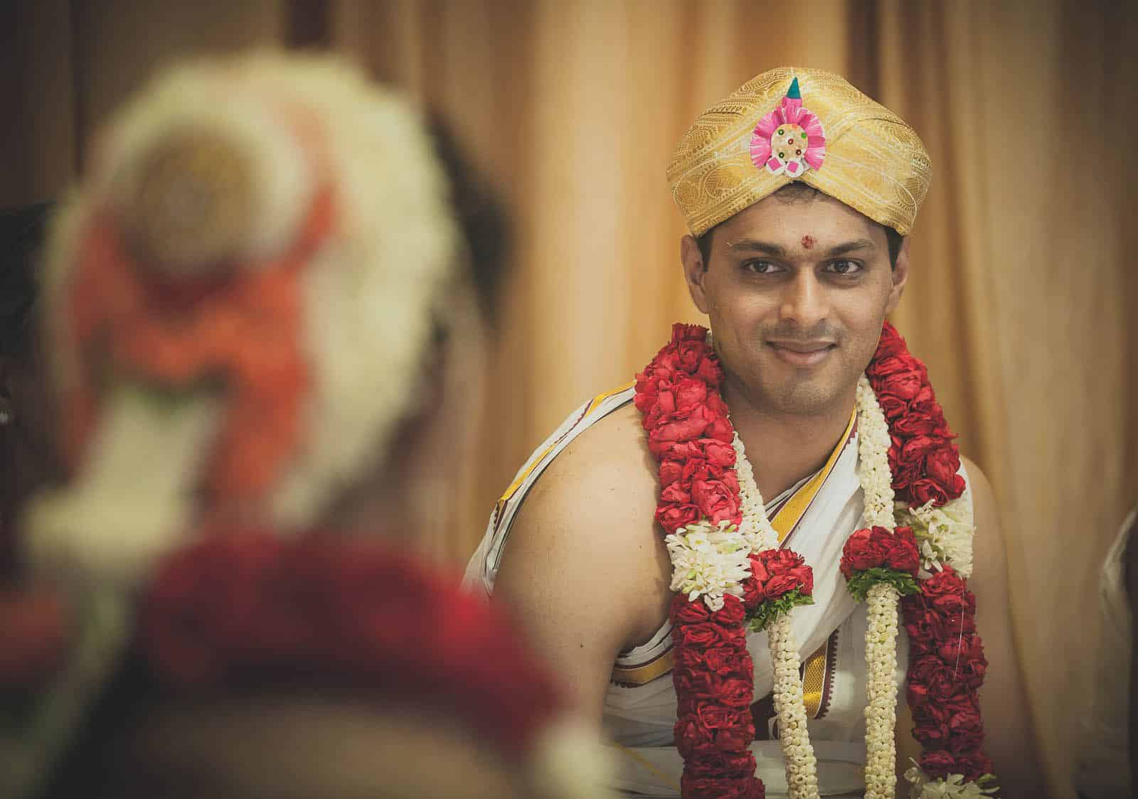 top-wedding-photographer-jaymahal-bangalore-groom-loving-eyes